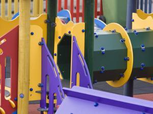 Colorful Playground Equipment in a Community Childrens' Park by Kent Kobersteen