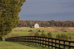 Fence, Field and Barn in the Fall at Sunset in Louisa County, Virginia by Kent Kobersteen