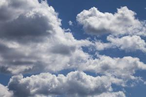 Fluffy Cumulus Clouds on a Late Summer Day by Kent Kobersteen