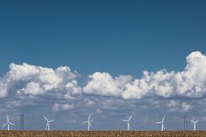 Heat Rising Off the Texas Prairie Distorts the Wind Generators of the Wind Farm by Kent Kobersteen