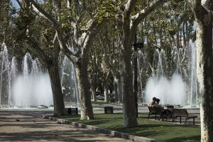 People Relaxing Near the Fountains at the Promenade Des Platanes by Kent Kobersteen