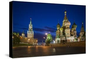 Spasskaya Tower, also Called Savior's Tower, and Saint Basil's Cathedral at Night by Kent Kobersteen