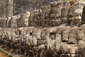Stone Statues of Evil Line the Right Side of a Bridge At Angkor Thom by Kent Kobersteen