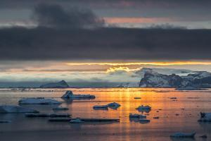 Sunset Off Andersson Island, with Coastal Mountains and Ice Floes by Kent Kobersteen