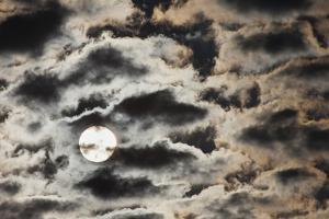 The Rising Sun Partially Obscured by Heavy Clouds by Kent Kobersteen