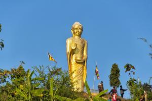 A golden statue of Buddha on the bank of Kaptai Lake, Rangamati, Chittagong Division, Bangladesh by Keren Su