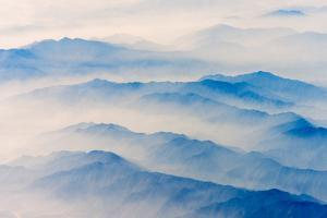 Aerial view of mountains, China by Keren Su