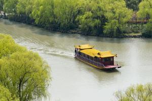 Boat on the South Lake, Jiaxing, Zhejiang Province, China by Keren Su