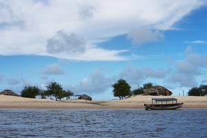 Boats and Sand Dune Along the Preguicas River, Maranhao State, Brazil by Keren Su