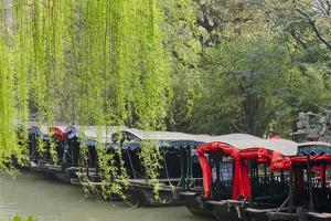 Boats with willow trees on the Grand Canal, Nanxun Ancient Town, Zhejiang Province, China by Keren Su
