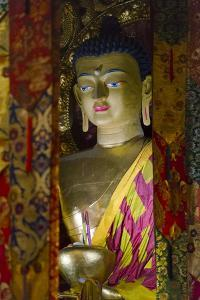 Buddhist statue in Tagong Monastery, Tagong, western Sichuan, China by Keren Su