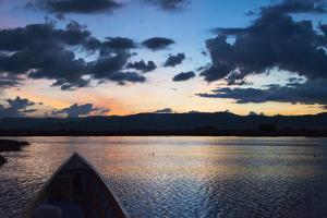 Canoe on Inle Lake at Sunset, Shan State, Myanmar by Keren Su