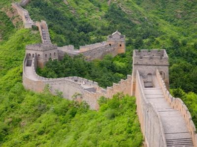 China, Hebei Province, Jinshanling, Landscape of Great Wall with Green Trees at Sunset by Keren Su