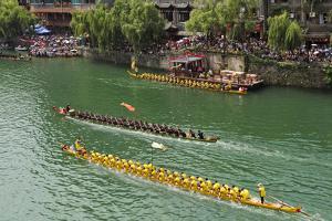 Dragon Boat race on Wuyang River during Duanwu Festival, Zhenyuan, Guizhou Province, China. by Keren Su