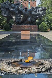 Eternal flame at World War II Memorial in Panfilov Park, Almaty, Kazakhstan by Keren Su