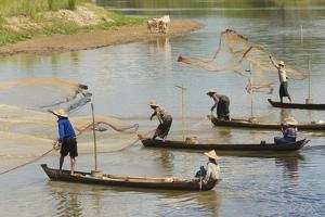 Fishermen fishing on the river, Bago, Bago Region, Myanmar by Keren Su