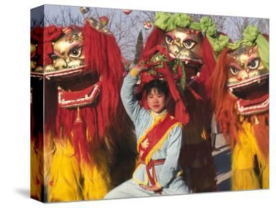 Girl Playing Lion Dance for Chinese New Year, Beijing, China