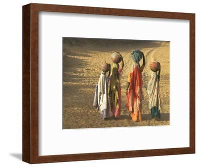 Girls Wearing Sari with Water Jars Walking in the Desert, Pushkar, Rajasthan, India