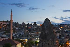 Houses and churches carved into the rock formations, Goreme, Cappadocia, Turkey by Keren Su