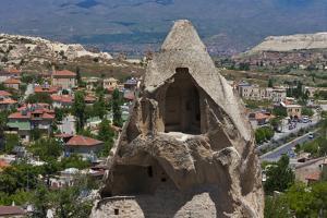 Houses carved into rock formation, Goreme, Cappadocia, Turkey by Keren Su