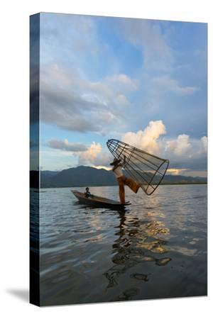 Intha Fisherman Rowing at Sunset on Inle Lake, Shan State, Myanmar