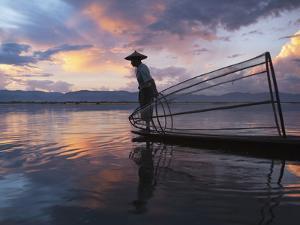 Intha Fisherman Rowing Boat with Fishing Net on Inle Lake, Myanmar, Asia by Keren Su
