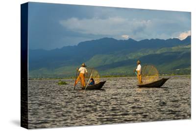 Intha Fisherman Rowing Boat with Leg on Inle Lake, Shan State, Myanmar