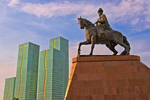 Kursk Building and Kenesary Khan Monument on the banks of Ishim River. Astana, Kazakhstan. by Keren Su