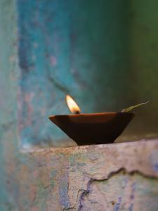 Lamp in a Little Shrine Outside Traditional House, Varanasi, India by Keren Su