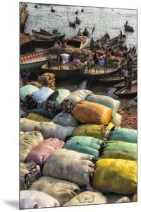 Loading sacks onto ferry boats on Buriganga River at Sadarghat, Dhaka, Bangladesh by Keren Su