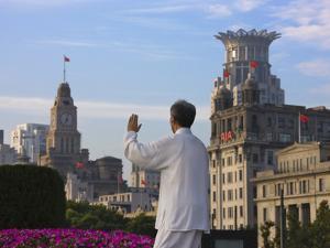 Man Practicing Taiji on the Bund, Shanghai, China by Keren Su
