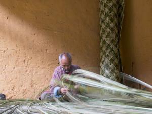 Man Weaving Bamboo Mat, Phobjikha Valley, Trongsa, Bhutan by Keren Su