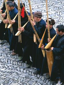 Miao Men Playing Traditional Bamboo Musical Instrument, China by Keren Su