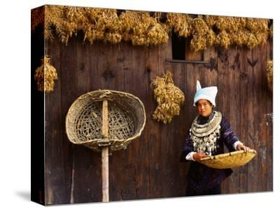 Miao Woman and Drying Produce