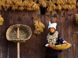 Miao Woman and Drying Produce by Keren Su