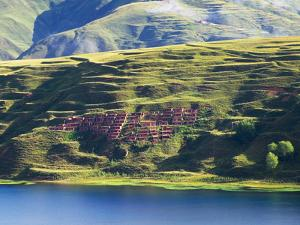 Monastery with Buddhist School in Yalang Sacred Mountain, Tibet-Sichuan, China by Keren Su