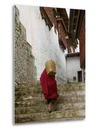 Monk Carrying Basket in Trongsa Dzong, Bhutan