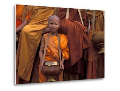 Monk with Alms Wok at That Luang Festival, Laos