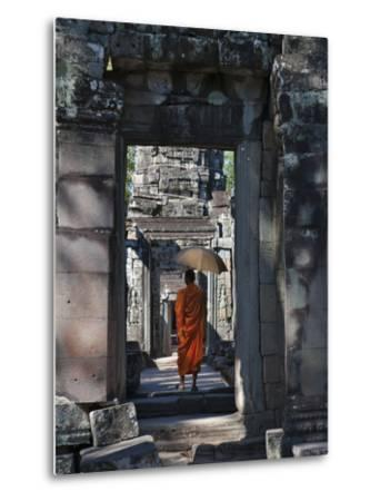 Monk with Buddhist Statues in Banteay Kdei, Cambodia