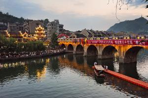Night view of bridge and pavilion on Wuyang River, Zhenyuan, Guizhou Province, China by Keren Su