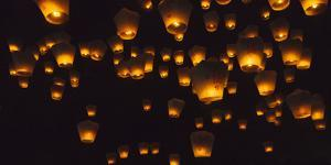 Night view of Sky Lanterns in the air during Chinese Lantern Festival, Shifen, Taiwan by Keren Su
