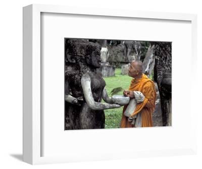Old Monk Praying at Xieng Khuan (Buddha Park), Laos