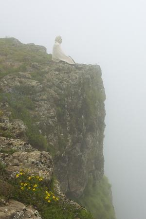 People on the cliff in morning mist, Simien Mountain, Ethiopia