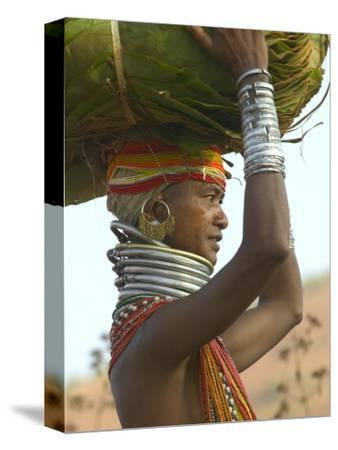 Portrait of a Bondo Woman Carrying a Load on Her Head Walking to Market, Early Morning