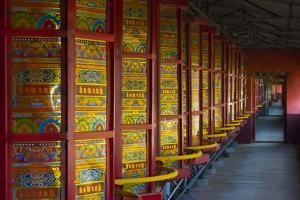 Prayer wheels in the temple, Tagong, western Sichuan, China by Keren Su