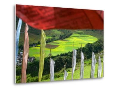 Praying Flags with Village and Farmlands at Pepe La Pass, Phobjikha Valley, Gangtey, Bhutan