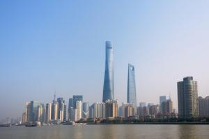 Pudong skyline dominated by Shanghai Tower by Huangpu River, Shanghai, China by Keren Su