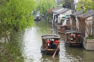 Rowing boat on the Grand Canal, Nanxun Ancient Town, Zhejiang Province, China by Keren Su