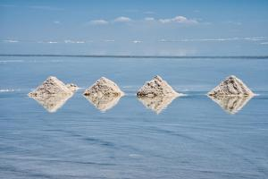 Salt cones on the reflected surface of the salt flat, Salar de Uyuni, Potosi Department, Bolivia. by Keren Su