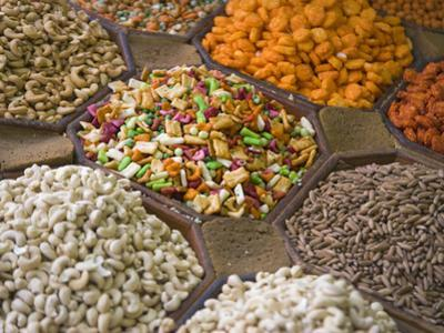 Selling Nuts and Dried Fruit at the Market, Dubai, United Arab Emirates by Keren Su